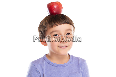 young boy child with red apple