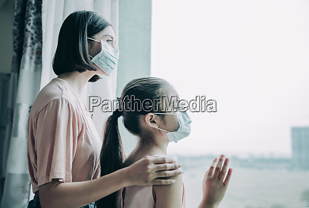 mother with daughter child in mask