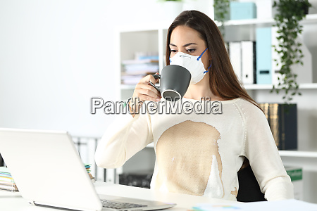 entrepreneur wearing mask with spilled coffee