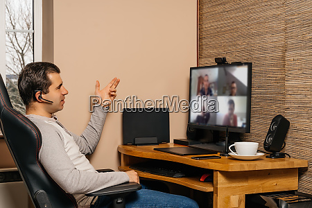 man talking on video conference with
