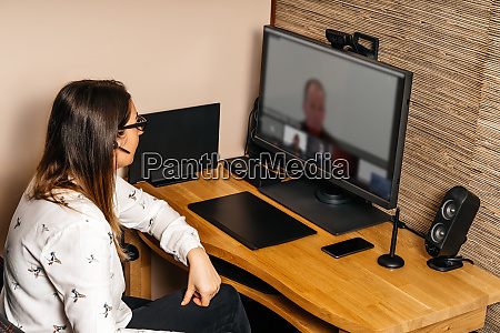 businesswoman talking on video conference from