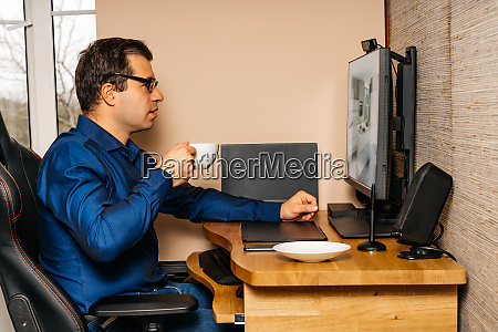 businessman working on computer from comfort