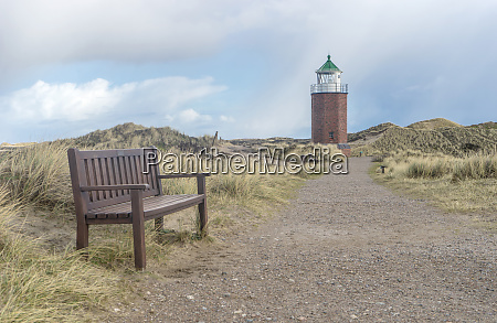 lighthouse and bench