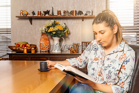 woman reading a book from comfort