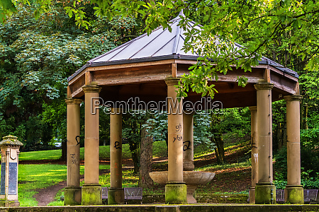 an old pavilion in a park