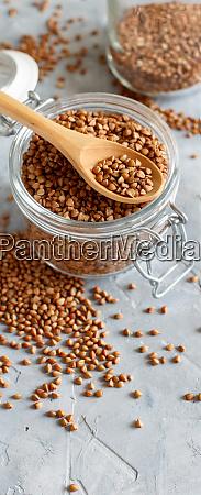 raw dry buckwheat grain in