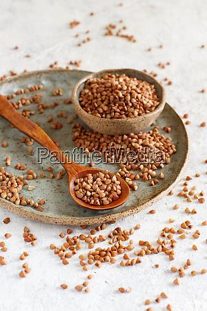 raw dry buckwheat grain on