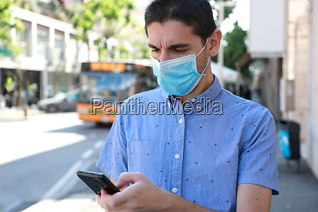 man with surgical mask updating information
