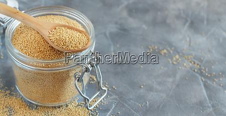 jar of raw amaranth seeds with