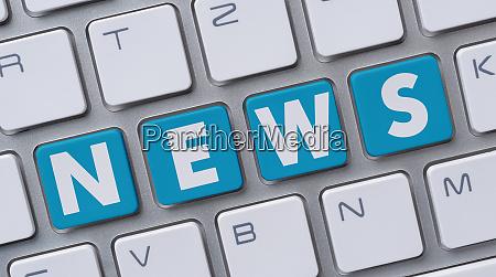 eine computertastatur mit dem wort news