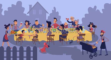 grosse familientreffen am tisch im freien