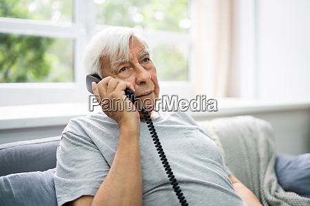 senior old man talking on telephone