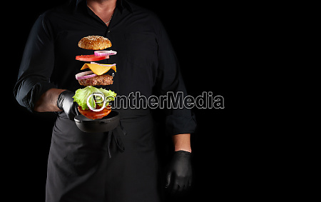 adult man in a black uniform