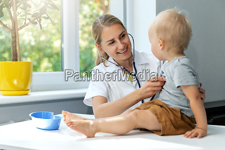 doctor examining a child patient by