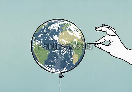 hand mit stift neben kugelballon