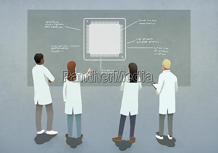 wissenschaftler diskutieren computerchip diagramm