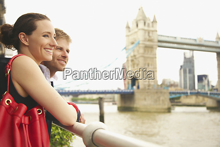 happy young couple enjoying view of