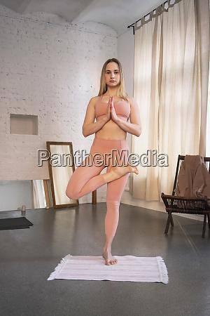 portrait confident young woman practicing yoga