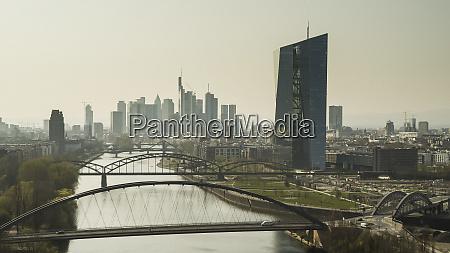sunny frankfurt cityscape and bridges over