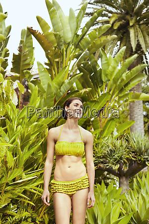 caucasian woman in bikini outdoors