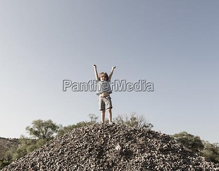 4 year old boy raising arms
