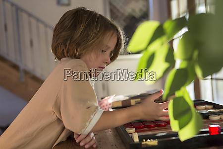 4 year old boy playing board
