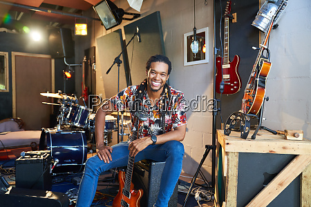portrait happy confident male musician with
