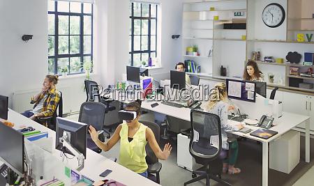 designers, working, at, desks, in, open - 28735690