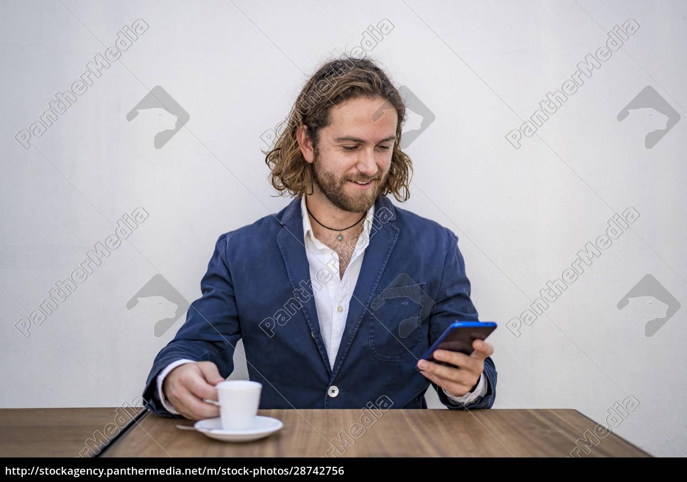 smiling, handsome, businessman, using, smart, phone - 28742756