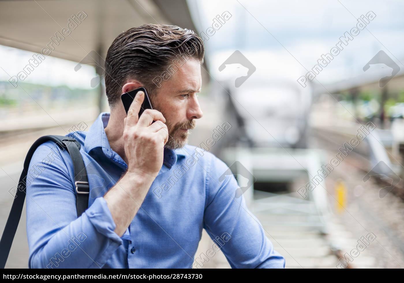handsome, businessman, talking, on, smart, phone - 28743730