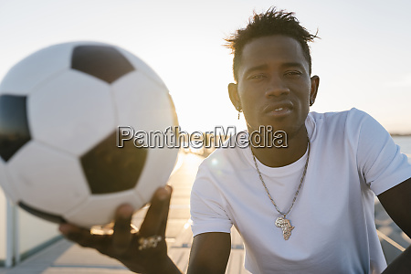 close-up, of, young, man, holding, soccer - 28744292