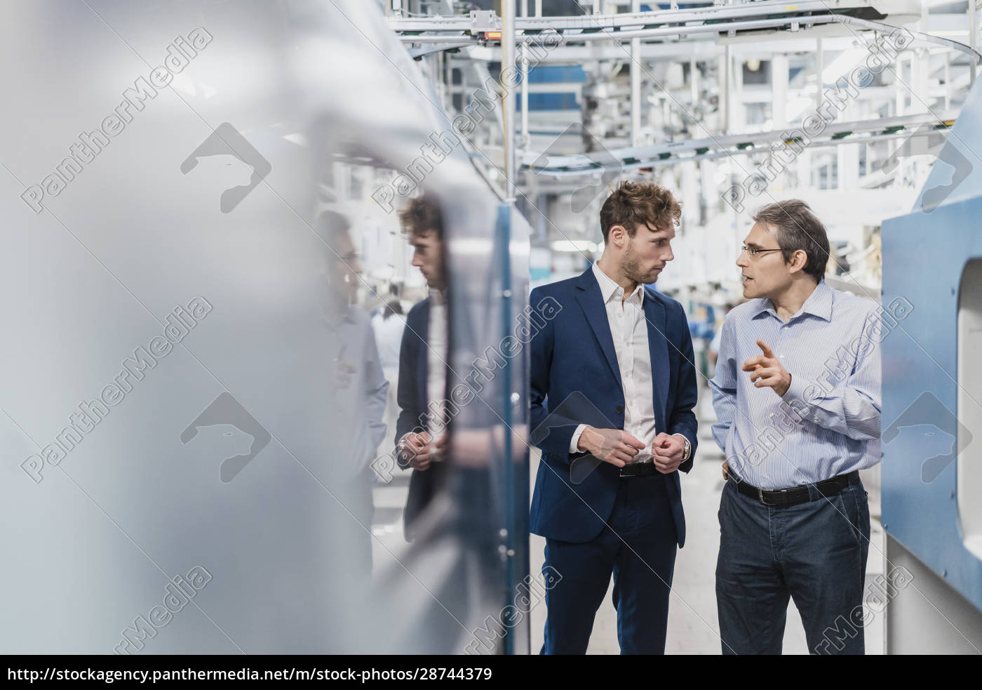 two, businessmen, having, a, meeting, in - 28744379