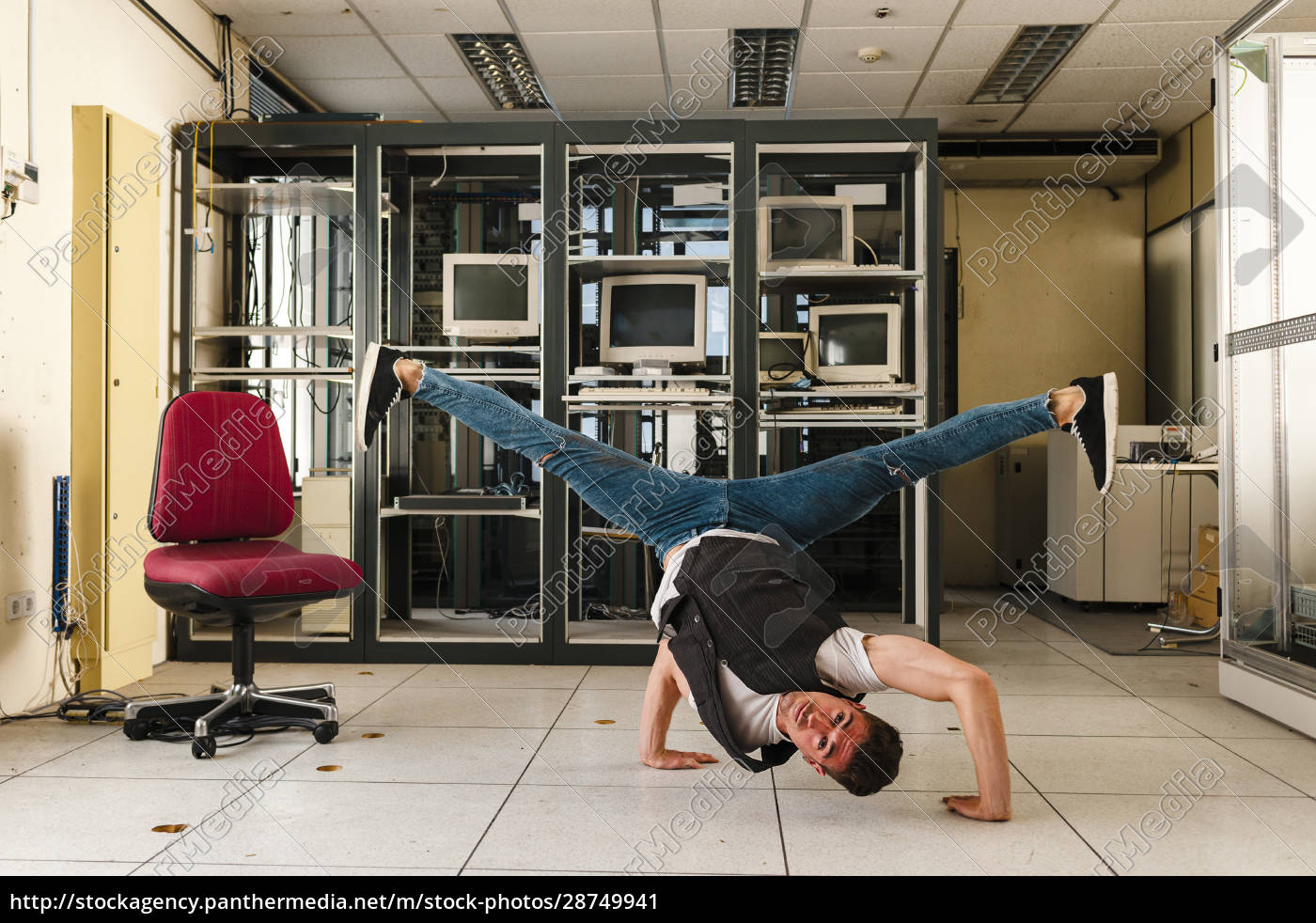 male, dancer, performing, stunt, on, floor - 28749941