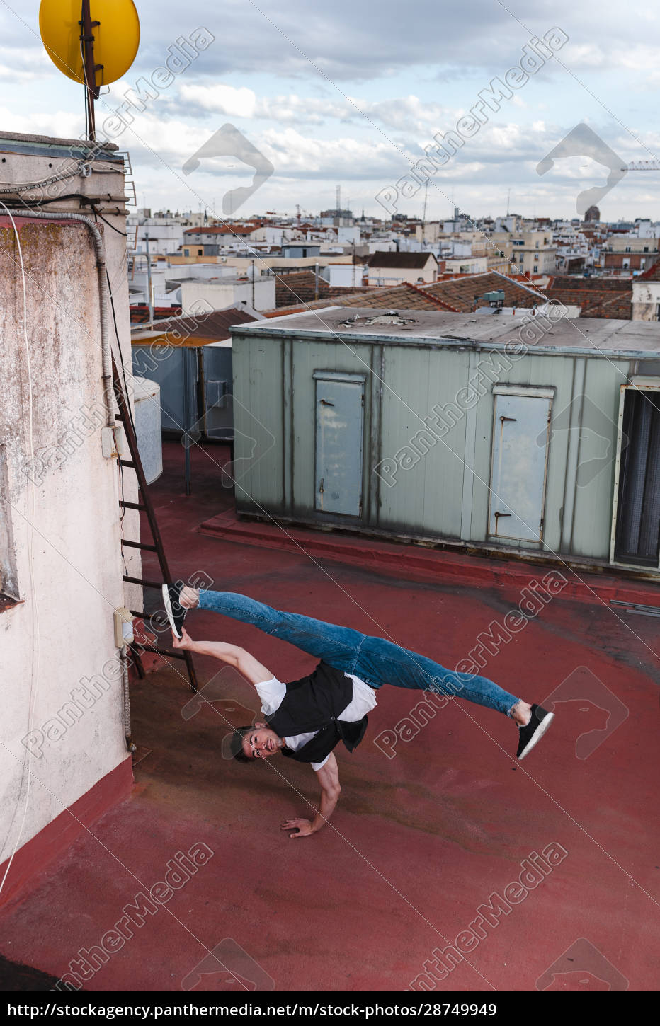 young, man, breakdancing, on, building, terrace - 28749949