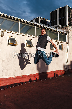 young, man, jumping, on, abandoned, building - 28749952
