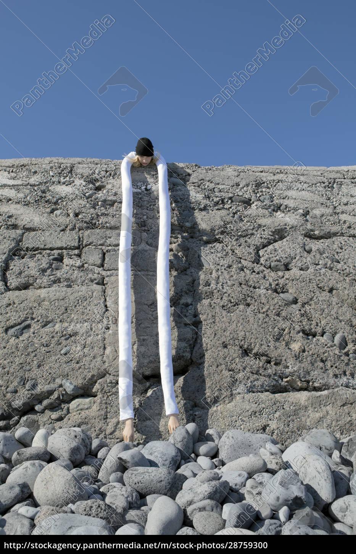 woman, with, artificial, long, hands, bending - 28759300