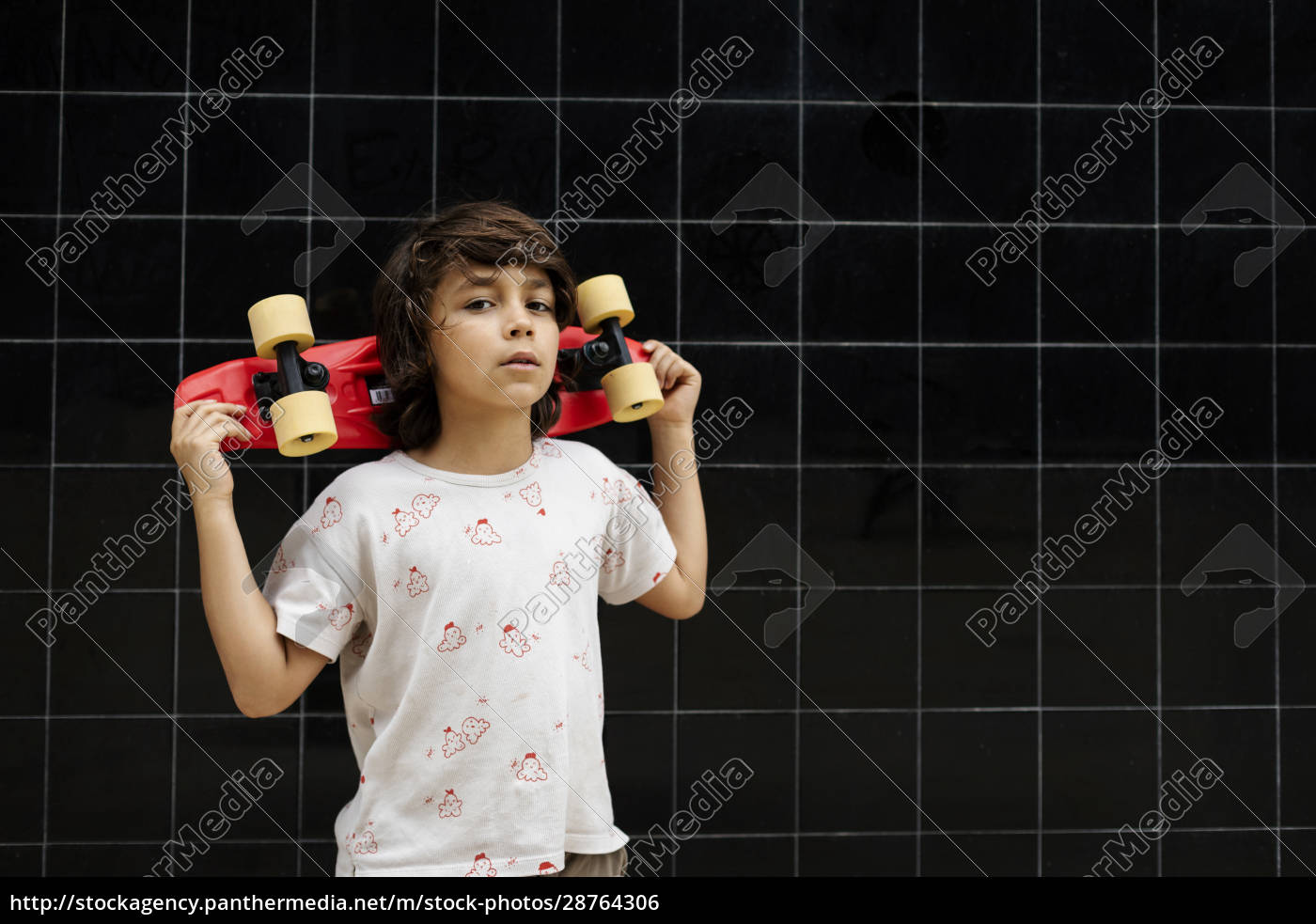 confident, boy, holding, skateboard, while, standing - 28764306