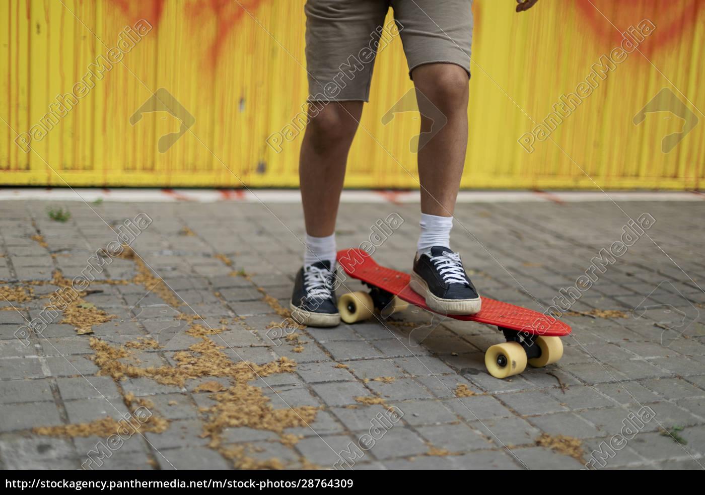 legs, of, boy, skateboarding, on, footpath - 28764309