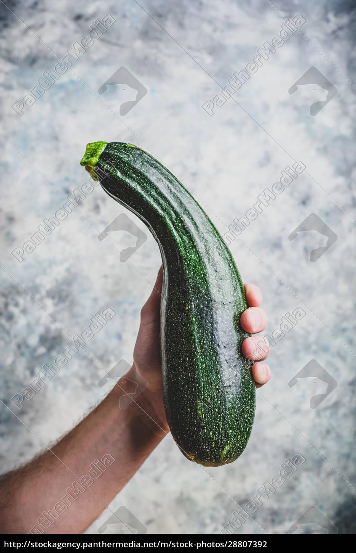 hand, holding, zucchini - 28807392