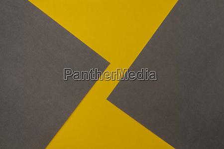 grauer und gelb erbunter papierhintergrund