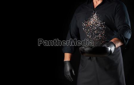man in a black uniform holding