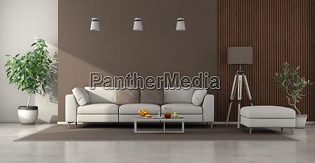 minimalistisches wohnzimmer mit weissem sofa braune