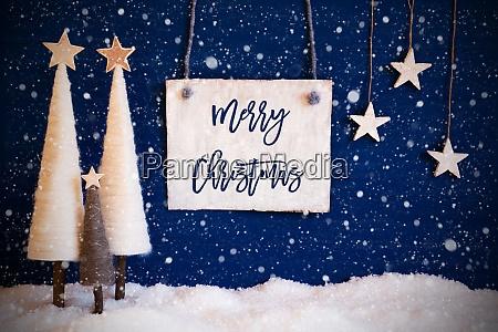 weihnachtsbaum blauer hintergrund schnee text frohe