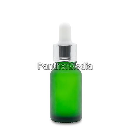 gruenes glas dropper serum flasche auf