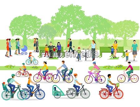 radfahrer und fussgaenger im park
