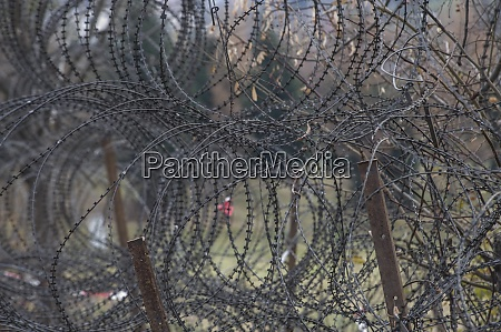 barbed, wire, fence, at, the, border - 28908677