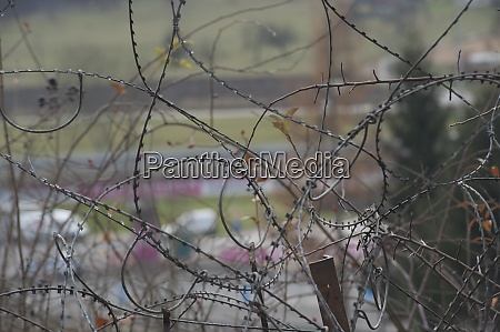 barbed, wire, fence, at, the, border - 28908684