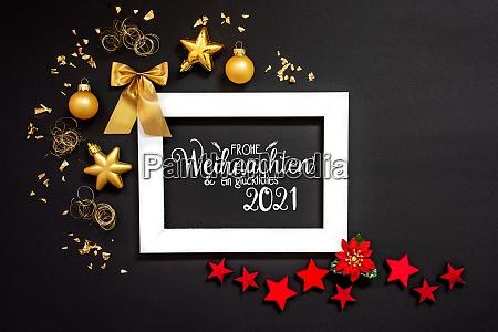 rahmen rot und goldene weihnachtsdekoration glueckliches