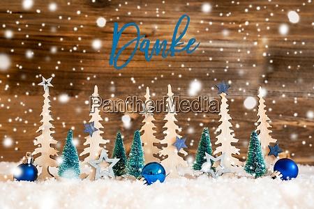 weihnachtsbaum schneeflocken blauer stern danke bedeutet