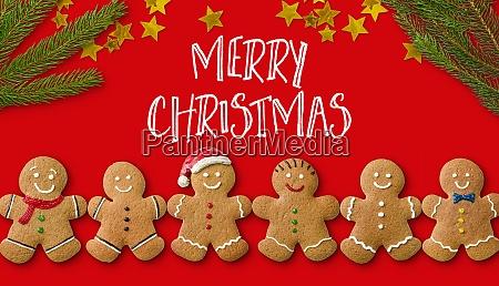 eine weihnachtskarte mit lebkuchenmaennern und weihnachtsdekoration